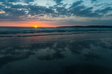 Scenic beach sunset landscape on the wild atlantic way coast in county Kerry, Ireland