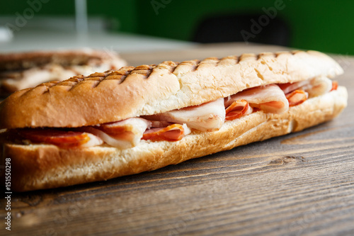 Staande foto Snack Toasted baguette sandwich with ham
