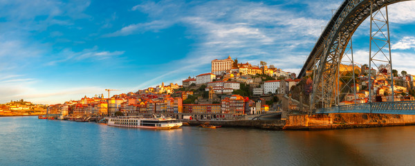 Panorama of Douro river, Ribeira and Dom Luis I or Luiz I iron bridge in the sunny morning Porto, Portugal.