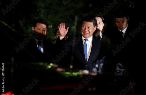 Chinese President Xi Jinping waves to U S  President Barack