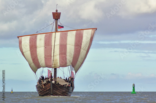 Canvas Prints Ship Hanseatic cog under sail with green and yellow buoy
