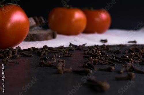 Fotografie, Obraz  Fresh tomatoes, homemade bread and cloves.