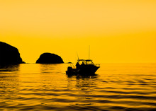 Vibrant Silhouette Of Sport Fishing Boat Reflecting On Calm Water