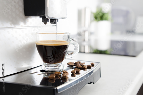 Home professional coffee machine with espresso cup. Fototapet