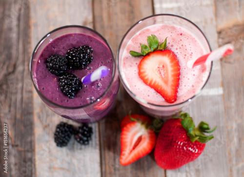 Foto op Aluminium Milkshake Milkshakes made with fresh blueberries and strawberries in a glass