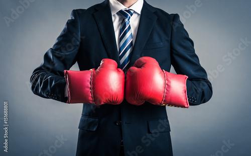 Fotografie, Obraz  ボクシンググローブを付けているビジネスマン