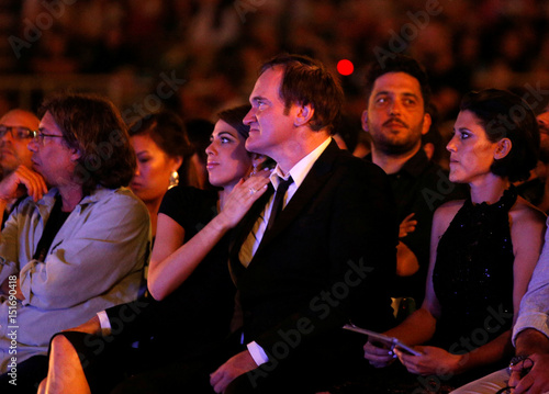 Director Quentin Tarantino sits next to Israeli singer Daniella Pick