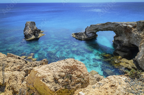 Beautiful natural rock arch near of Ayia Napa, Cavo Greco and Protaras on Cyprus island, Mediterranean Sea. Legendary bridge lovers.
