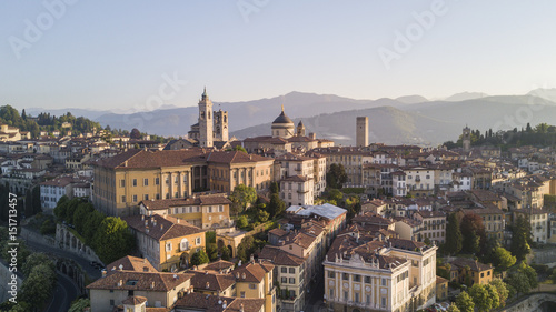 Cadres-photo bureau Milan Drone aerial view of Bergamo - Old city. One of the beautiful city in Italy. Landscape on the city center, its historical buildings and towers during a wonderful blu day