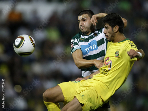 By Miguel Vidal   REUTERS. Pazos de Ferreira s Bura and Sporting s Vukcevic  battle for the ball during their Portuguese Premier League b10de012d620d