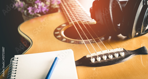 Photo Music composer equipments with guitar and headphone for songwriting