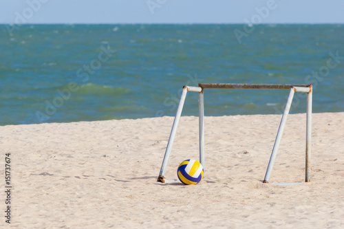 Portable iron soccer goal with yellow volleyball on the beach in Thailand