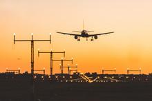 Airplane Landing At Sunset, Silhouette