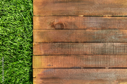 Wooden board on green grass, picnic related design template