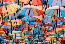 Colorful Umbrellas Hanging In Sky