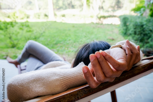 Door stickers Chicken Young woman lying on soft mattress in relaxing bed at terrace with green nature view