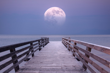 FototapetaFull moon and viewpoint platform at sea dusk