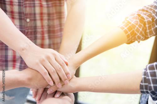 Fototapety, obrazy: young college student joining hand, business team touching hands together - unity, harmony, teamwork, friends concept