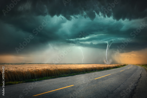 Spoed Foto op Canvas Grijze traf. Tornado and thunder storm on agricultural meadow at sunset