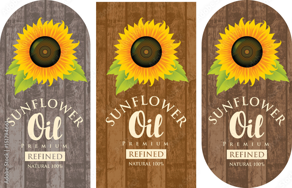 Fototapety, obrazy: set of three vector labels for refined sunflower oil with sunflower and the inscription on wooden background