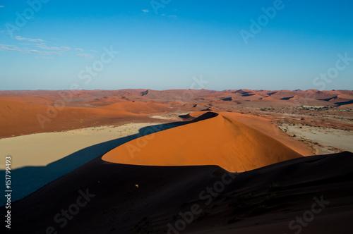 Tuinposter Algerije Climbing Big Daddy Dune during Sunrise, Looking onto Sossusvlei Salt Pan, Desert Landscape, Namibia