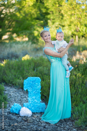 Beautifull Mother Lady Mom In Stylish Blue Dress Together With Her Son And Number One Birthday