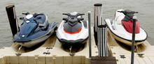 Three Docked Jet Skis.