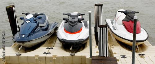 Photo Three docked jet skis.