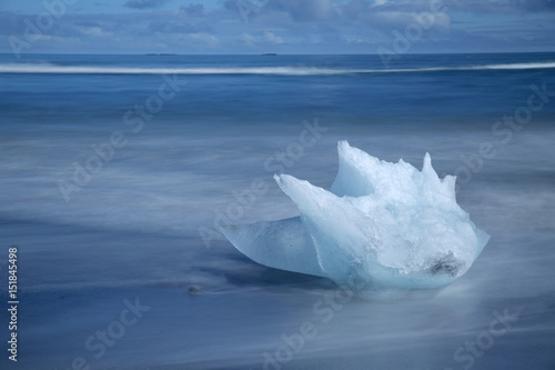 Spoed Foto op Canvas Poolcirkel Icebergs,Ice,Ice formation, details of ice from the Jokulsarlon glacial lagoon washed up on a nearby volcanic sand beach from the North Atlantic Ocean, Iceland