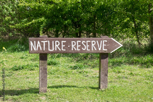 Rustic sign for nature reserve in field Fototapeta