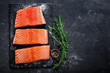 Raw Salmon Filet On Dark Slate...