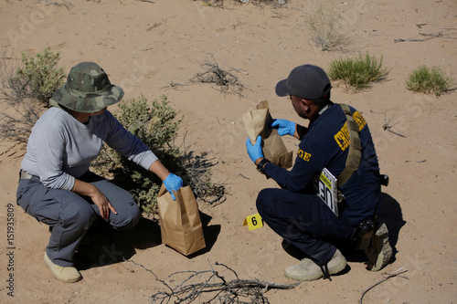 Crime investigator collect evidence as activists and