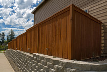 Wood Fence And Cement Blocks Retaining Wall