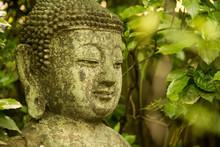 Stone Buddha Sculpture In A Zen Garden In Japan