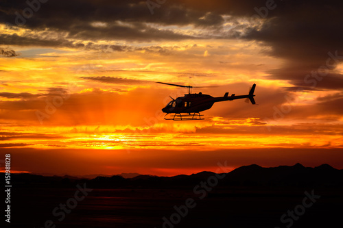 Garden Poster Helicopter Bell 206 at sunset