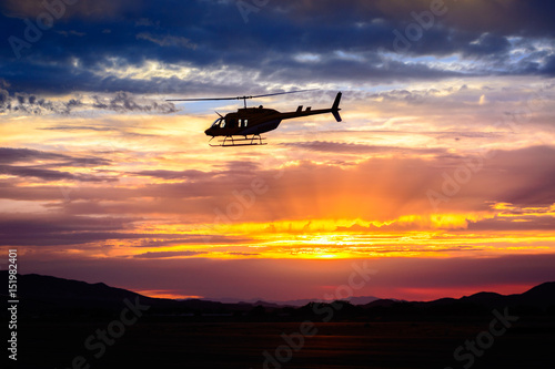 Poster Helicopter Bell 206 at sunset