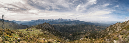 Fényképezés  Dramatic panoramic view of snow capped mountains of northern Corsica