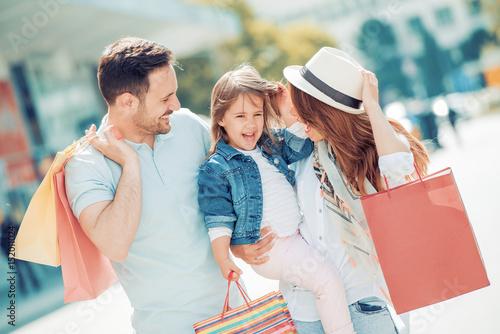 Young family enjoying shopping