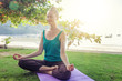 Young woman doing yoga outdoors. Healthy lifestyle, meditation, lifestyle concept