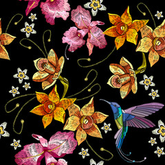 Fototapeta Ogrody Humming bird, orchid exotic tropical flowers seamlees pattern. Beautiful classical embroidery, humming-bird, orchids, tropical flowers. Template for clothes, embroideries, t-shirt design