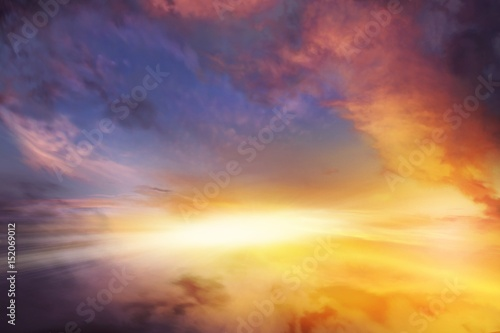 fototapeta na ścianę Sunset sky . Sunset or sunrise with clouds, light rays and other atmospheric effect . background sky at sunset and dawn