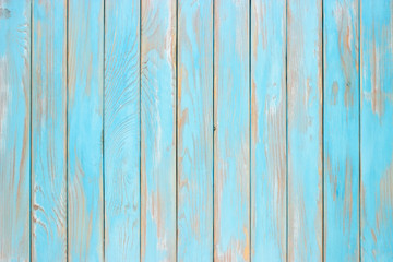 Blue wood planks, a shabby wooden surface of the kitchen table