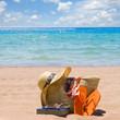 sunbathing accessories on sandy beach by the sea