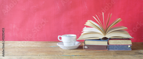 open book and cup of coffee on red background,free copy space Wallpaper Mural