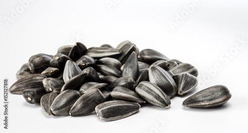 Fototapeta Heap of sunflower seeds on the white background. obraz