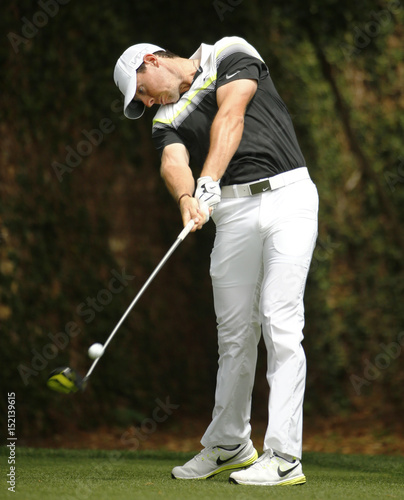 Rory McIlroy of Northern Ireland hits a driver off the second tee ...