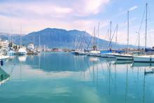 Sailboats Reflected On Sea Kal...