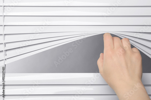 Fotomural  Human hand opening blinds