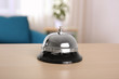 Silver service bell on reception desk