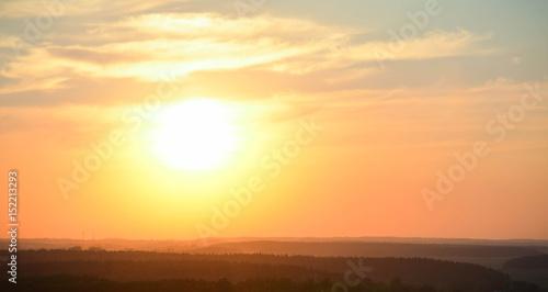 Natural sunset sunrise over forest © Giddrid
